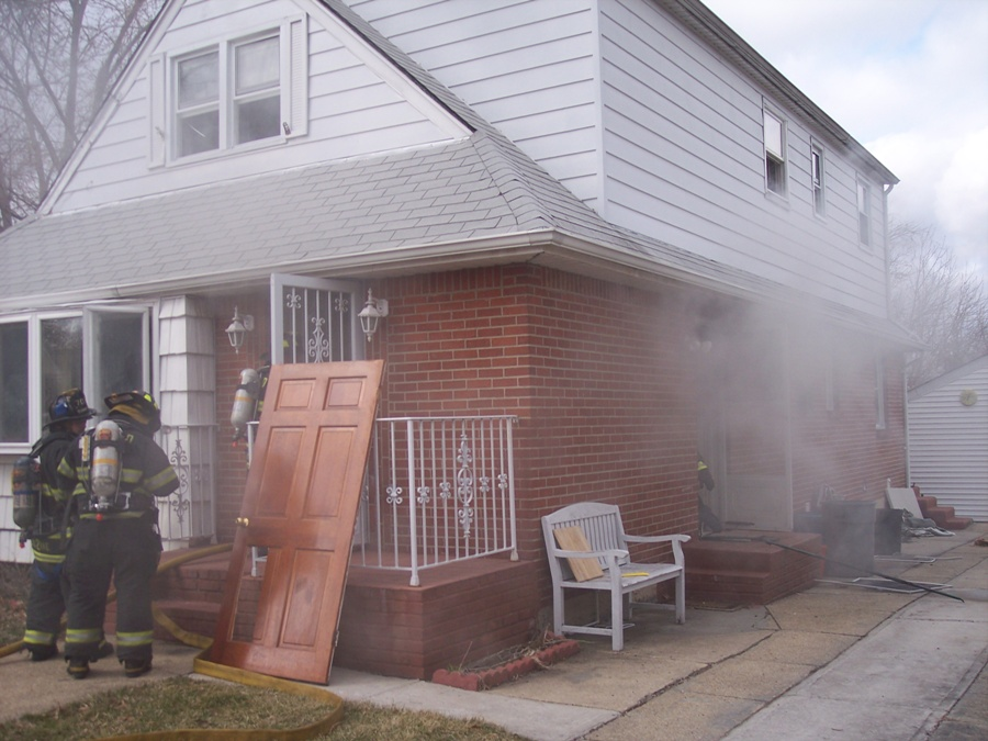 Firefighters enter dwelling